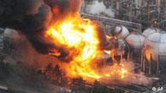 Fireball rises over oil refinery