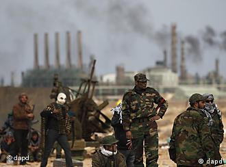 Libyan rebels stand on the outskirts of the eastern town of Ras Lanouf, Libya