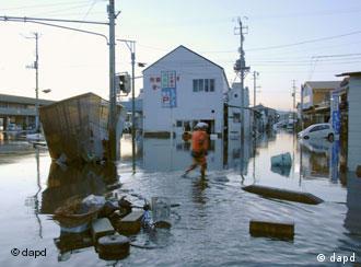 Man walks through flooded areas