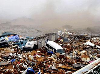 Cars and other debris swept away by tsunami waves