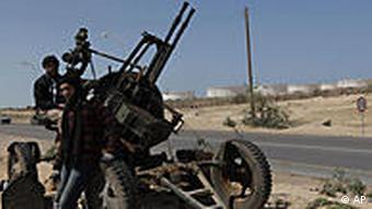 Two Libyan rebels manning an anti-aircraft weapon