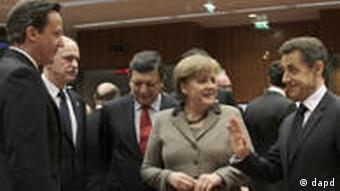 From left, British Prime Minister David Cameron, Greek Prime Minister George Papandreou, European Commission President Jose Manuel Barroso, German Chancellor Angela Merkel and French President Nicolas Sarkozy share a word at an EU Summit in Brussels on Friday, March 11, 2011.