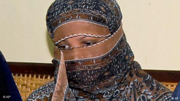 In this Nov. 20, 2010, file photo, Pakistani Christian woman Asia Bibi listens to Governor of Pakistani Punjab Province Salman Taseer at a prison in Sheikhupura near Lahore, Pakistan. (AP Photo)