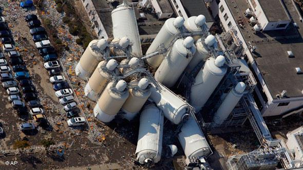 Factory facilities look damaged in an industrial complex in Sendai, northern Japan