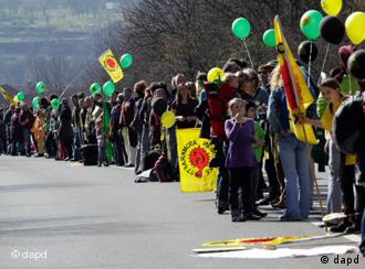 A human chain of protesters demanding that Germany stop using atomic energy
