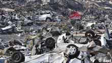In this photo taken Sunday, March 13, 2011, debris covers Otsuchicho town, northern Japan, two days after a powerful earthquake-triggered tsunami hit the country's east coast. (Foto:The Yumiuri Shimbun, Yasuhiro Takami/AP/dapd) JAPAN OUT, CREDIT MANDATORY