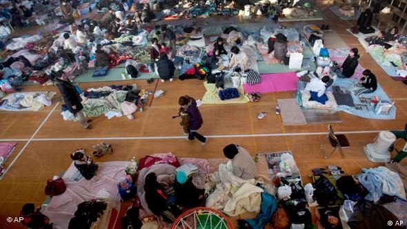 Japanese refugees rest inside a school gymnasium where hundreds took shelter in Sendai, northeastern Japan, on Monday, March 14, 2011 following Friday's massive earthquake and the ensuing tsunami. (AP Photo/David Guttenfelder)