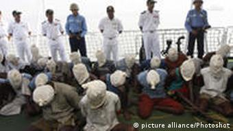 (110210) -- MUMBAI, Feb. 10, 2011 () -- Suspected Somali pirates sit with their faces covered with cloth sacks on the deck of an Indian Coast Guard vessel in Mumbai, India, Feb. 10, 2011. Twenty-eight pirates were presented to the media on Thursday, after they were captured following a brief exchange of gunfire in the Indian Ocean, an official said. () (wjd)