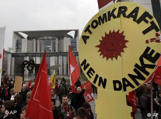 demonstrators with Nuclear power- no, thank you' logo