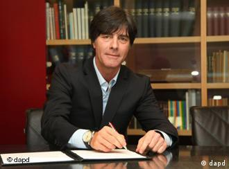 Joachim Löw signs his new contract in front of the press in Frankfurt