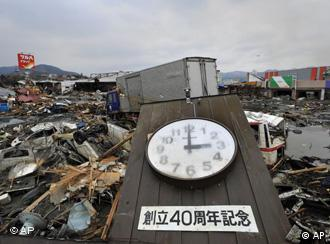 A clock indicates the time the tsunami struck