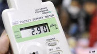 A pocket radiation detector shows 2.9 micro-sieverts per hour at an evacuation center in Koriyama