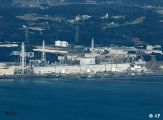 Fukushima Dai-ichi nuclear power plant is pictured before helicopters dump water on the stricken reactor to cool overheated fuel rods inside the core Thursday morning, March 17, 2011. (AP Photo/Kyodo News) JAPAN OUT, MANDATORY CREDIT, NO LICENSING IN CHINA, HONG KONG, JAPAN, SOUTH KOREA AND FRANCE