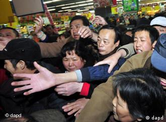 Shoppers mob a supermarket in China to purchase salt