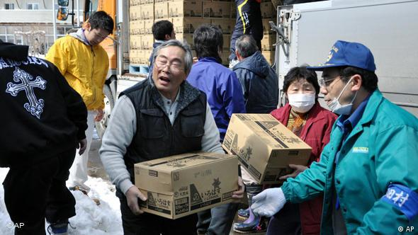 Evacuees help to carry the boxes containing bottles of water into a shelter in Tanohata, northern Japan Thursday, March 17, 2011 following Friday's massive earthquake and tsunami. (AP Photo/Kyodo News) JAPAN OUT, MANDATORY CREDIT, NO LICENSING IN CHINA, HONG KONG, JAPAN, SOUTH KOREA AND FRANCE