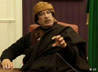 This video image taken from Turkish television Libyan leader Moammar Gadhafi is seen during an interview with the TV channel TRT, in Tripoli, Libya, Tuesday March 8, 2011. Gadhafi said in an interview broadcast Wednesday that Libyans would fight back if Western nations impose a no-fly zone to prevent the regime from using its air force to bomb government opponents staging a rebellion. (AP Photo/TRT)