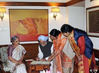 Prime Minister Manmohan Singh and his wife Gurcharan being visited by census officials