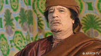 In this image taken from RTP Portugal TV, filmed in Tripoli, Libya, Thursday March 17, 2011, showing Libyan leader Moammar Gadhafi, during an interview as he comments on the prospects of a United Nations resolution against Libyan government forces. The interview made available Friday March 18, was filmed Thursday before the United Nations voted to authorize the use of all necessary measures to protect civilians under attack by government forces in Libya. (Foto:RTP Portugal TV/AP/dapd) TV OUT - PORTUGAL OUT - Mandatory credit RTP TV