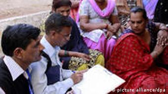 A census official collects information from eunuchs during the second phase of the census in India