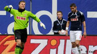 Michael Rensing and Youssef Mohamad of Cologne during the 6-2 defeat to Hamburg