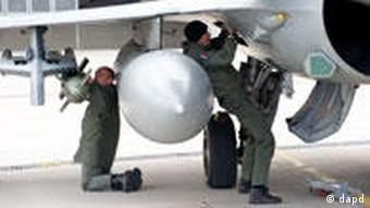 French service personnel preparing a Rafale jet fighter at the military base of Saint Dizier