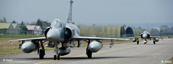 This photo provided by the French Army shows a French Mirage 2000 jet fighter before taking off for Libya at the military base of Dijon, central France, Saturday, March 19, 2011.