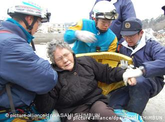 Japanese rescue personnel rescue 80-year-old Sumi Abe in the Miyagi prefecture, Japan