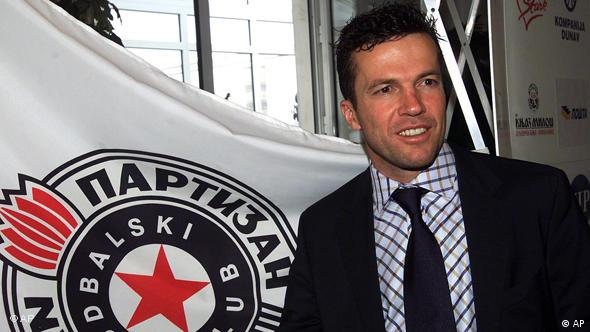 Former German World Cup star Lothar Matthaeus poses for photographers in front of the FK Partizan flag after the press conference, in Belgrade on Monday Dec. 23 2002. Matthaeus signed an agreement on Sunday to coach FK Partizan Belgrade for a full year.(AP Photo/Mikica Petrovic)