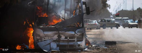 A bus burns on a road leading to the outskirts of Benghazi, eastern Libya, Sunday, March 20, 2011.