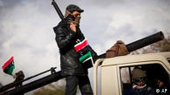 rebel holding rifle standing on back of truck