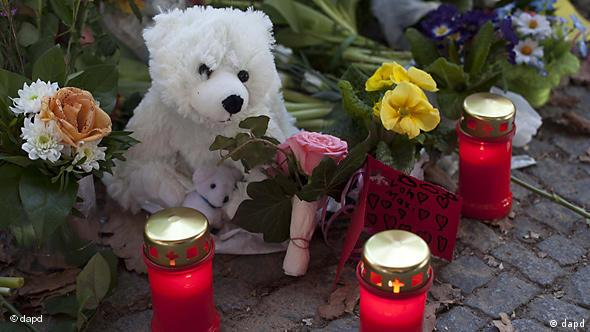 Stuffed Knuts, candles and flowers lay at the entrance of the Zoo to commemorate late polar bear Knut
