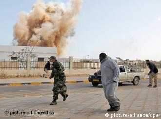 A bomb explodes in the distance in March 2011 in Libya Photo: KHALED ELFIQI +++(c) dpa - Bildfunk+++