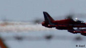 Royal red arrows aerobatic planes pass over the RAF (Royal Air Force) Akrotiri a British military base near southern port city of Limassol, Cyprus, Monday, March 21, 2011. The European Union's top foreign policy official brushed aside concerns Monday that the coalition supporting military action against Libyan leader Col. Moammar Gadhafi is already starting to fracture, saying the head of the Arab League was misquoted as criticizing the operation.Early Sunday, U.S. French and British planes began bombarding Libyan military targets with a barrage of Tomahawk cruise missiles and precision bombs. Late in the day, a cruise missile blasted Gadhafi's residential compound.(Foto:Petros Karadjias/AP/dapd)