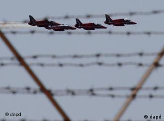 Fighter planes seen through barbed wire
