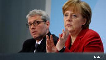 Bundeskanzlerin Angela Merkel und Umweltminister Norbert Röttgen (Foto: dapd)