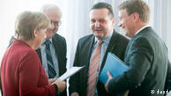 Merkel talking with others