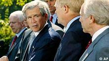 President Bush looks toward House Minority Leader Dick Gephardt,second from right, D-Mo., and Sen. Joe Liberman, right D-Conn., as he announces agreement on a resolution giving him authority to oust Saddam Hussein, in the White House Rose Garden, Wednesday, Oct 2, 2002. Bush is flanked by Democratic and Republican lawmakers including Sen. John McCain, left, R-Ariz, As part of the deal with the House, Bush bent to Democratic wishes and pledged to certify to Congress before any military strike, iffeasible, or within 48 hours of a U.S. attack that diplomatic and other peaceful means alone are inadequate to protect Americans from Saddam's weapons of mass destruction. (AP Photo/Doug Mills)