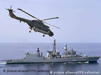 German navy warship and helicopter