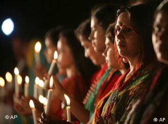 Bangladeshis participate in a candle light vigil at the Liberation War Museum to mark the killing of thousands of unarmed Bengalis by the then West Pakistani forces in 1971