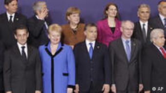 Front row left to right, French President Nicolas Sarkozy, Lithuania's President Dalia Grybauskaite and Hungarian Prime Minister Viktor Orban, European Council President Herman Van Rompuy and Cypriot President Dimitris Christofias. Back row left to right, Slovenia's Prime Minister Borut Pahor, Portugal's caretaker Prime Minister Jose Socrates, German Chancellor Angela Merkel, Finland's Prime Minister Mari Kiviniemi and Austrian Chancellor Werner Faymann stand for a group photo at an EU summit in Brussels, Thursday, March 24, 2011. Portugal's political crisis and uncertainty over the true scale of problems at Irish banks dominated a summit of European Union leaders that was designed to finally put an end to the region's crippling debt crisis. (AP Photo/Yves Logghe)