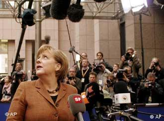German Chancellor Angela Merkel looks up during arrivals for an EU summit in Brussels, Thursday, March 24, 2011. Portugal's political crisis and uncertainty over the true scale of problems at Irish banks dominated a summit of European Union leaders that was designed to finally put an end to the region's crippling debt crisis. (AP Photo/Elisa Day)