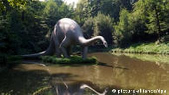 A model dinosaur in a lake