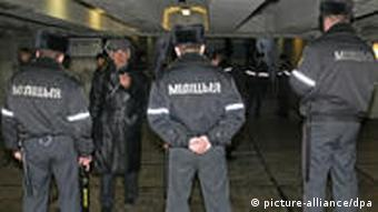 Police block the entrance to the underground prior to an opposition rally in Minsk in March 2011