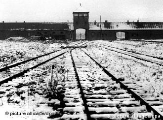 Entrance to Auschwitz with train tracks in foreground