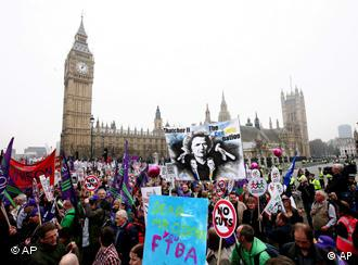 Demonstrators march past Parliament Square in London