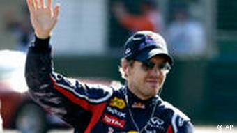 Red Bull Formula One driver Sebastian Vettel of Germany waves to fans during the drivers' parade ahead of the Australian Formula One Grand Prix in Melbourne, Australia, Sunday, March 27, 2011. (AP Photo/David Callow)