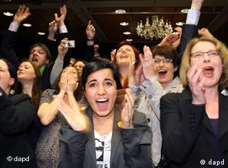 Green party members celebrate