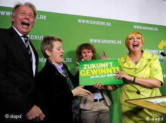 Green party leaders celebrate after the election