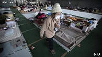 An evacuee walks at the main floor of a gymnasium that has turned into an evacuation center in Yamagata, Yamagata Prefecture, northern Japan, Sunday, March 27, 2011 in Japan. The magnitude-9 quake off Japan's northeast coast March 11 triggered a tsunami that barreled onshore and disabled the Fukushima Dai-ichi nuclear power plant. (AP Photo/Eugene Hoshiko)