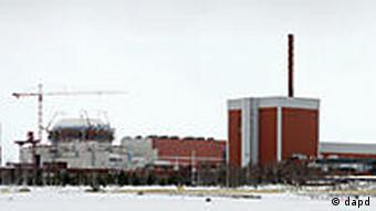 In this March 23, 2011 photo, a general view shows the nuclear power plant Olkiluoto 3 'OL3' under construction next to OL2 and OL1 nuclear reactors in Eurajoki, south-western Finland. Halfway around the globe from Japan's atomic emergency, engineers building a cutting-edge nuclear reactor along Finland's icy shores insist the same crisis could never happened there. And that's not only because Finland is seismically stable. The 1,600-megawatt European Pressurized Reactor projected to come online in 2013 in Olkiluoto, 195 miles (315 kilometers) northwest of Helsinki, is the first of its kind expected to begin operating after the Japanese disaster. (Foto:Lehtikuva, Antti Aimo-Koivisto/AP/dapd) FINLAND OUT NO SALES